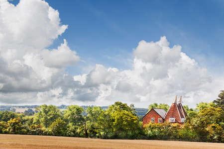 nestled: Oast house nestled in trees, Hollingbourne, Kent