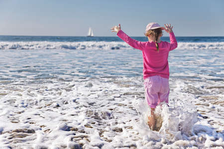Young girl gets wetter than she planned as a wave soaks her Stock Photo - 9787715