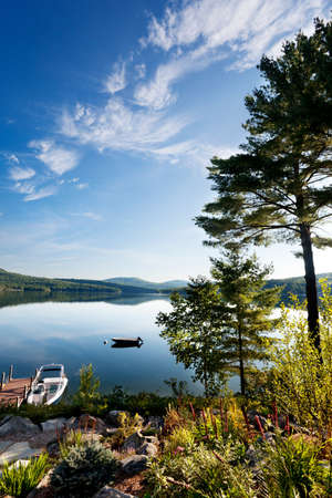 Bright morning sunlight over a clear New Hampshire lake photo