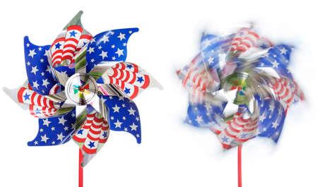 Stars & stripes pinwheels, stationary & spinning, isolated photo