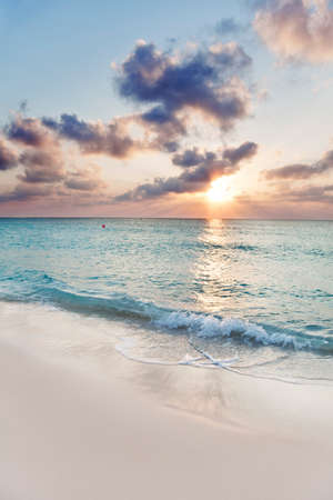 mile: Sun about to set over Seven Mile Beach, Grand Cayman