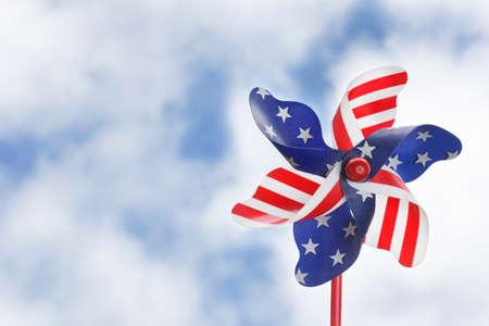 Stars & stripes pinwheel against a summery sky photo