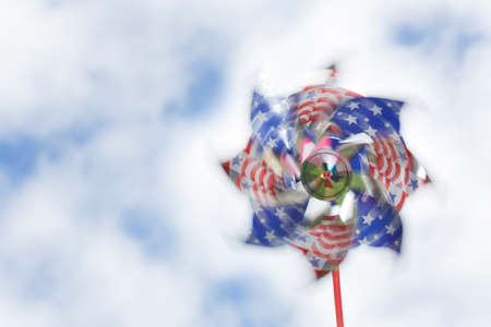 Shiny stars & stripes pinwheel spinning against a summery sky photo