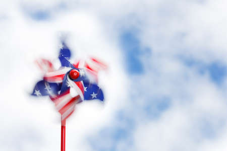 Swirls of motion blur in a spinning stars & stripes pinwheel photo