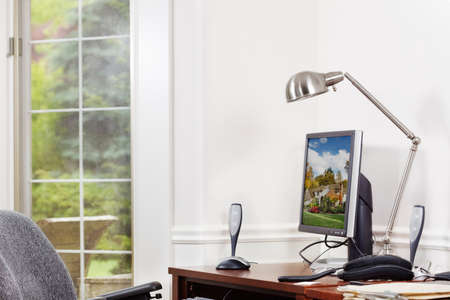 Bright, tidy home office. Clipping path for monitor image. Stock Photo