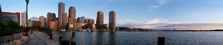 View of the city from the harbor in the early morning sun on a clear summer day, Boston, Massachusetts photo