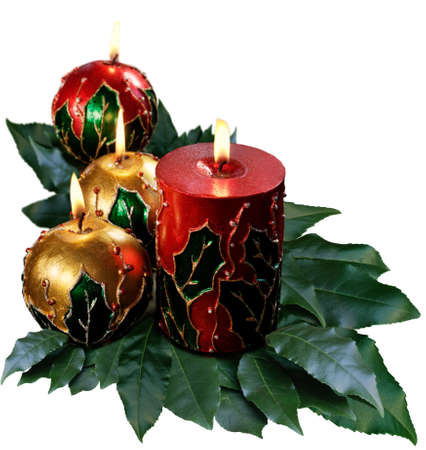 christmas decorations: Christmas candles amidst foliage and berries