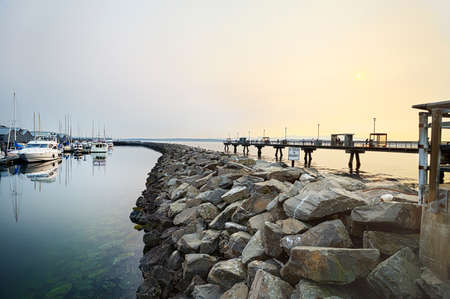 edmonds: Hazy summer sun going down over the pier in Edmonds