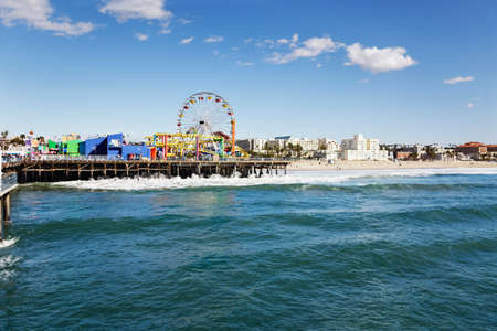 Amusement park on Santa Monica pier with the beach in the background