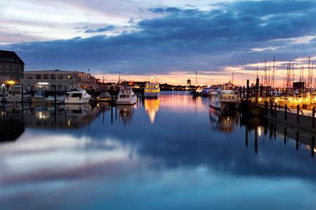 Pre-dawn light at the docks in Boston Harbor Stock Photo