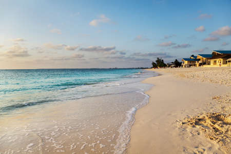 mile: Sunset light warms Seven Mile Beach, Grand Cayman
