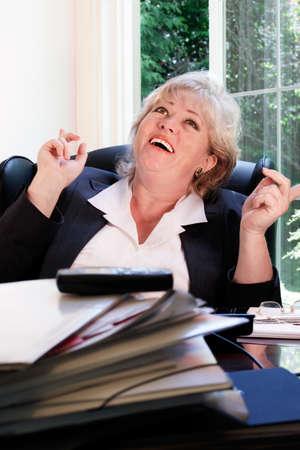 exuberance: A burst of exuberance in spite of the work pile! Stock Photo