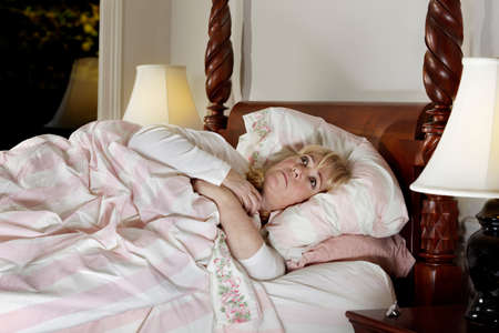 Mature woman wide awake in the middle of the night photo