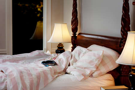 Eyeshade and earplugs on the bed photo