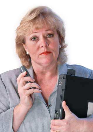 road warrior: Mature businesswoman with cell phone and laptop