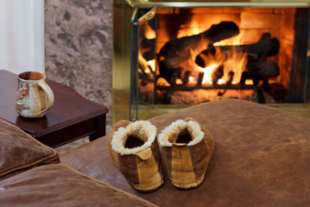 couches: Coffee mug & slippers by the fire Stock Photo