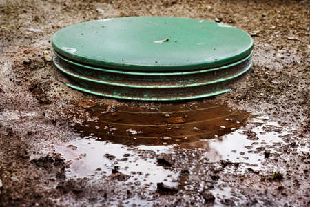 septic: Leaks around the locking lids of a septic systems tanks Stock Photo