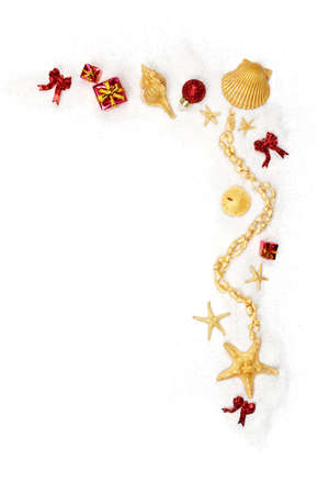 Ornaments and shells painted gold on a white sand background Stock Photo - 9821078