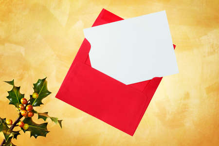 Holiday card an envelope on a hand painted gold background photo