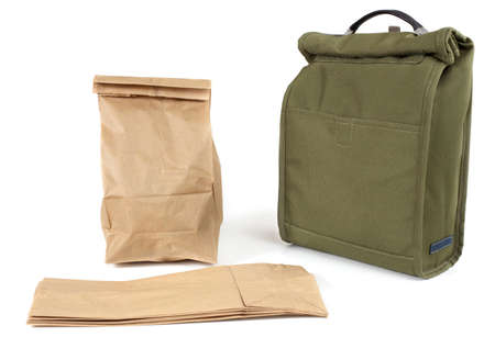 reusable: Disposable paper lunch bags or re-usable fabric sack? Archivio Fotografico