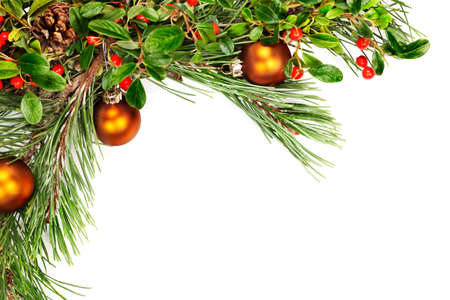 Holiday garland with ornaments, pine branches, pine cones and evergreen with berries (Common BearberryKinnikinnick) photo