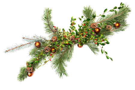 Holiday garland with ornaments, pine & spruce branches, pine cones and evergreen with berries photo