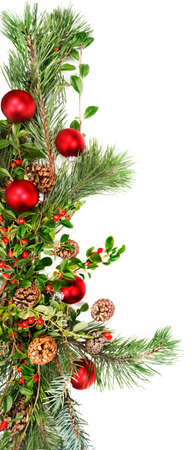 Holiday garland with red ornaments, pine & spruce branches, pine cones and evergreen with berries (Common Bearberry/Kinnikinnick).  Stock Photo - 9821343