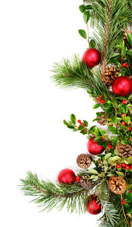 Holiday garland with red ornaments, pine & spruce branches, pine cones and evergreen with berries (Common Bearberry/Kinnikinnick) Stock Photo - 9821368