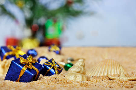 christmas gift: Christmas ornaments in the sand - blue packages Stock Photo