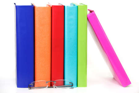 Row of colorful books with reading glasses Stock Photo - 9821784