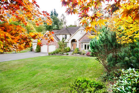 Suburban home in early Autumn as the leaves begin to turn Stock Photo - 9821921