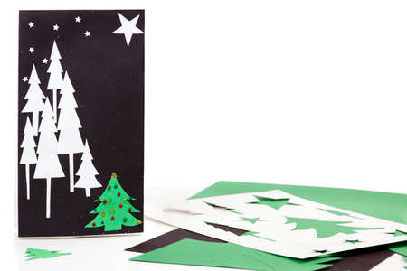 Construction paper, bag, and stencils to make Christmas gift bags photo