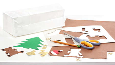 Construction paper, bag, stencils, pencil and scissors to make Christmas crafts Stock Photo - 9829888