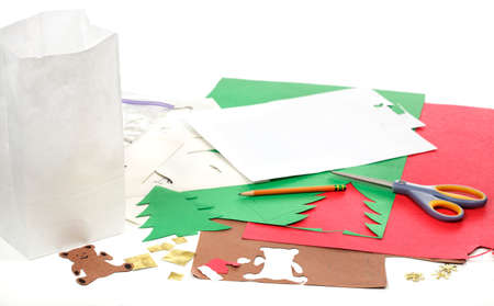 Construction paper, bag, stencils, pencil and scissors to make Christmas crafts photo