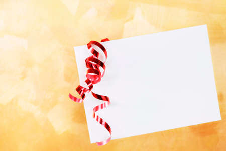 White envelope with red curling ribbon over a gold hand painted background Stock Photo - 9829911