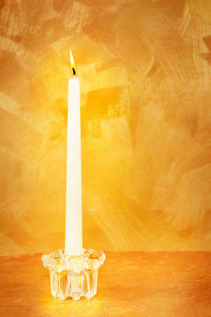 candle: Candle flame lights hand painted gold background Stock Photo