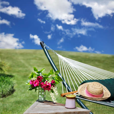 summer clothing: Relaxing summer garden with hammock Stock Photo