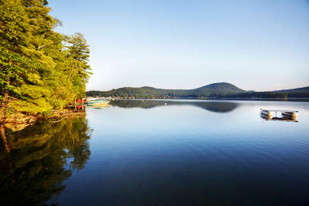 pontoon: Summer morning on a calm New Hampshire lake