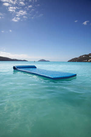 Drifting off on the calm waters of a tropical bay photo