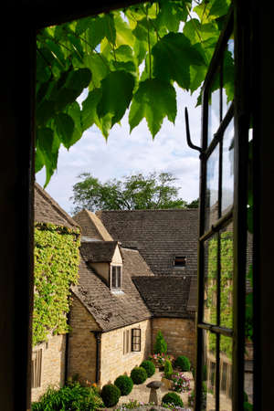 windows frame: View through a cottage window into the courtyard