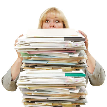Mature woman almost buried by a mountain of paperwork Stock Photo - 9847326