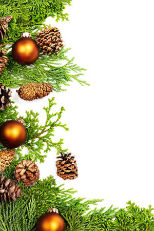 xmas background: Frame of pine & fir branches,  pine cones and Christmas decorations