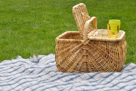 basket: Picnic basket on blanket Stock Photo