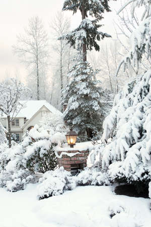 Driveway light and house on a snowy morning Stock Photo