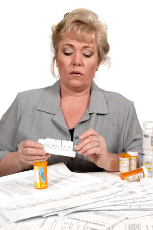 Loading up the weekly pill dispenser Stock Photo - 9859578
