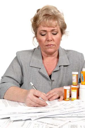 puzzling: Puzzling over the mass of medical insurance forms Stock Photo