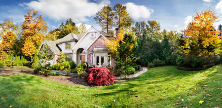 residential home: Panorama of a suburban house on a sunny fall afternoon Stock Photo
