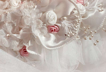 Detail from pink and white bridal veil and headdress photo