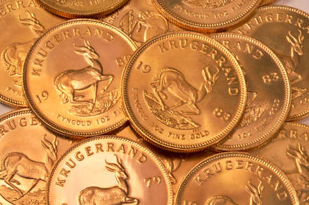 Pile of gold coins (South African Krugerrands) photo