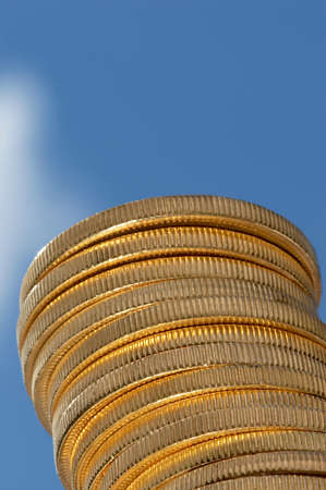 Tower of gold coins, reaching skyward photo